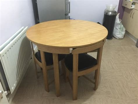 circular dining tables and chairs hygena alena oak circular dining table and 4 chairs
