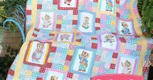 cuddly quilt kit featuring s pets by darlene