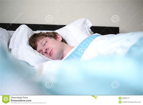 man sleeping in bed man sleeping in bed at home stock photos image 32028773