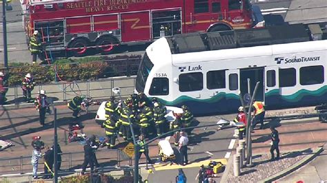 1 hurt as car collides with link light rail in s