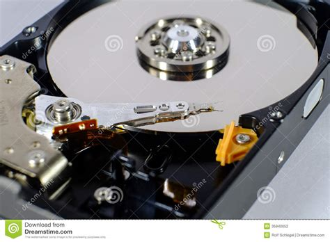 drive photo read and write head of a open harddisk drive stock photo