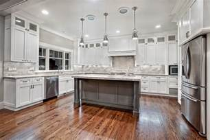 White Kitchens With Islands Awesome Varnished Wood Flooring In White Kitchen Themed Feat Antique White Cabinets Design Also