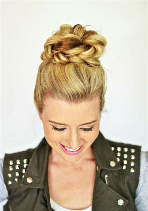 how to put the world s greatest hair buns with braids putting braids in a top knot 5 top knot variations you ll