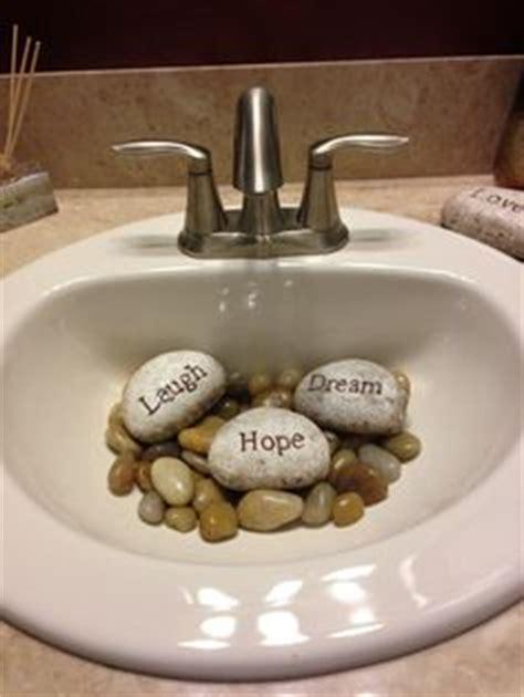river rocks in bathroom sink river rocks in the bathroom sink a feng shui but a
