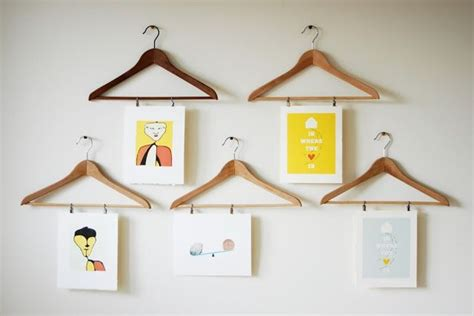 unique ways to hang pictures simple creative ways to hang art shop displays pinterest