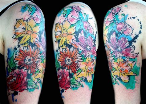half sleeve watercolor tattoo of different flowers 31 watercolor tattoos