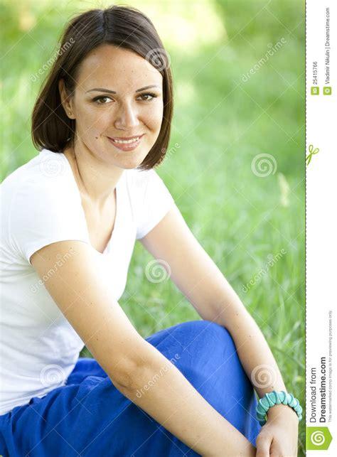 beautiful teen beautiful teen girl in the park at green grass royalty