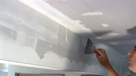 Ceiling Compound by Removing Excess Joint Compound Between Corner Bead Of Wall Opening As Part Of Home Makeover