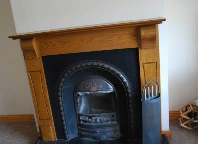 solid wood fireplace and cast iron insert for sale in