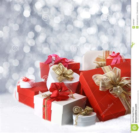 christmas gifts against sparkling party lights stock image