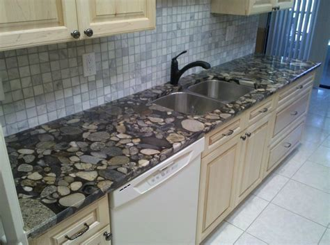 natural maple cabinets with granite countertops 28 best vibrant red granite kitchen countertops images on