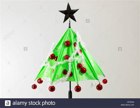green umbrella with christmas decorations against white