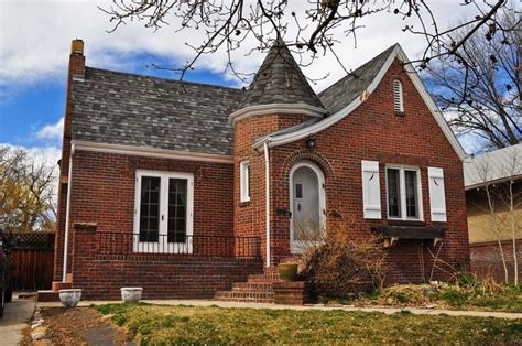 tudor style homes with roof finials features distinctive mission style parapets a low pitched