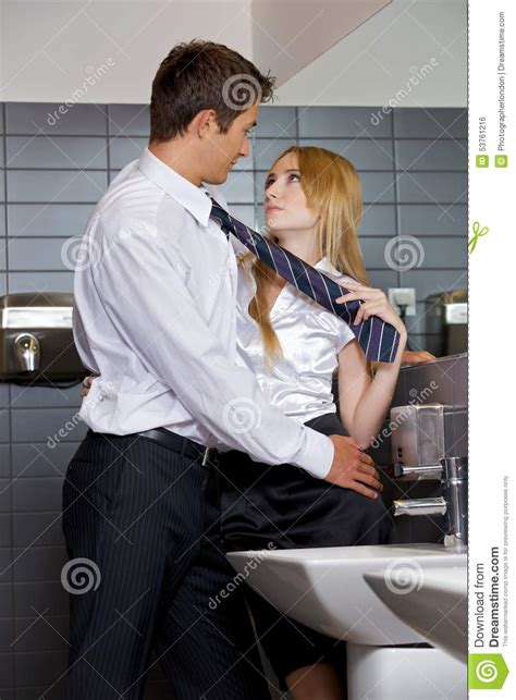 bathroom seks young business couple flirting with each other at office
