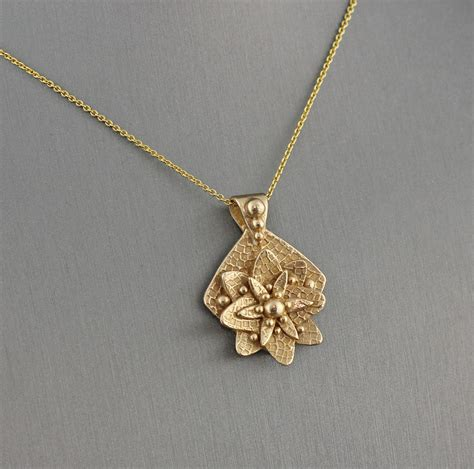 Handmade Gold Pendants - stylized flower necklace handmade gold bronze metal clay