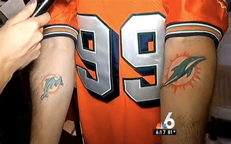 miami dolphins tattoos fan gets of new dolphins logo hopes owner pays for