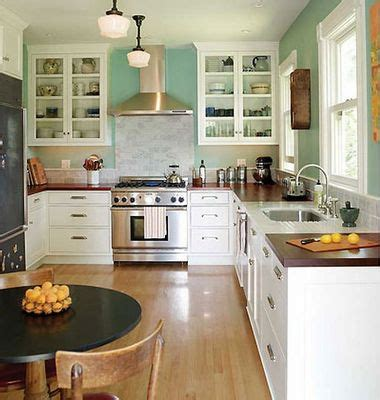 wood countertops white cupboards white subway tile