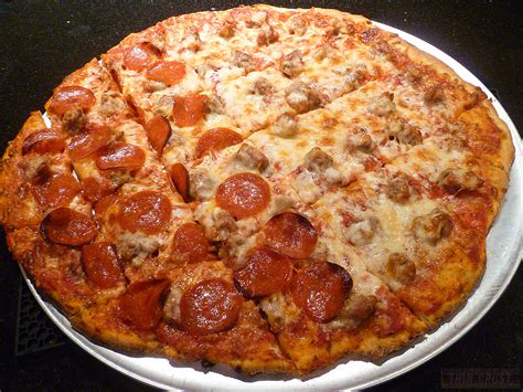 pizza with in crust chicago thin crust pizza yes it s a thing real