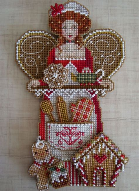 cross stitch christmas ornament on plastic canvas crafts