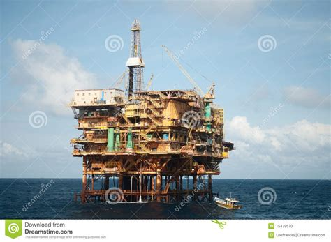 offshore drilling boats offshore oil rig with fishing boat stock photo image