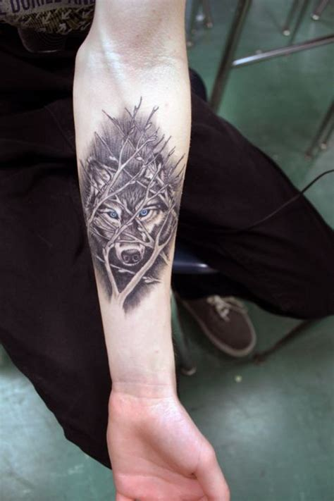 awesome wolf tattoo designs awesome wolf tree branches forearm