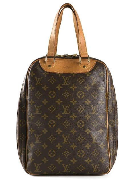 lyst louis vuitton excursion shoe bag  brown