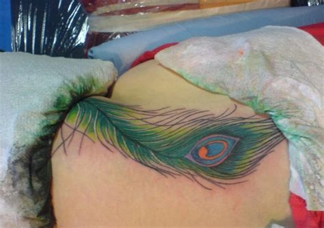 feather tattoo lower back lower back peacock feather tattoo creativefan