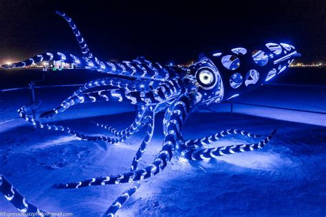 hand crafted giant squid flexes  mechanical tentacles