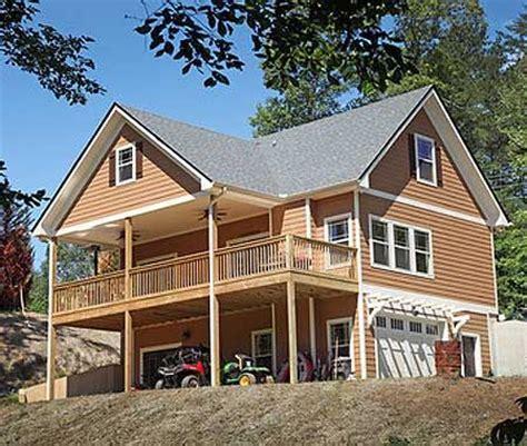 garage under house plans plan 24114bg vacation cottage with drive under garage