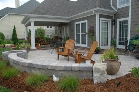 grey brick patio backyard ponds a druble wall