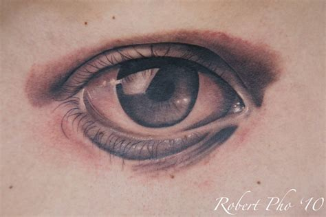 eye design tattoo grey ink eye on back