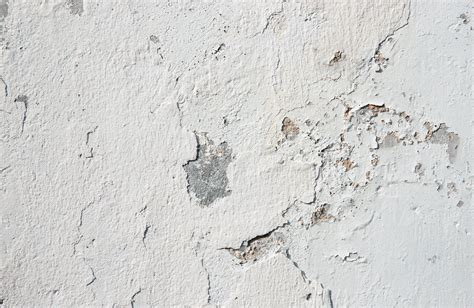 white concrete wall grunge background texture from an old white concrete wall
