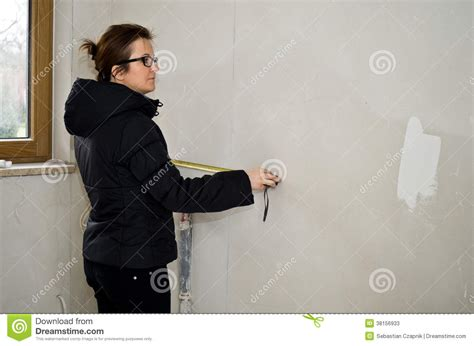 women using the bathroom woman measuring in new bathroom stock photos image 38156933