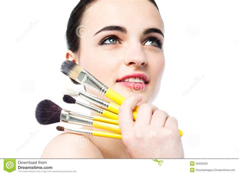 persona vanidosa beautiful holding makeup brushes stock photos