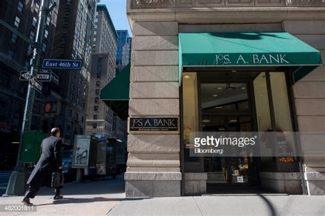 jos a bank nyc a pedestrian walks in front of a jos a bank store in new