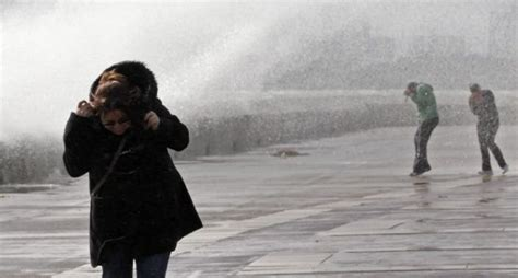 uk hit with 65mph winds and heavy rain as severe weather