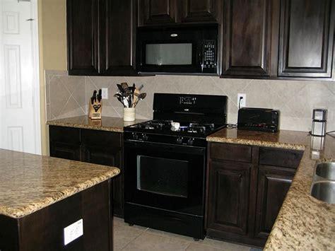 black appliances  java cabinets kitchen pinterest