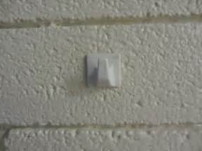 hang items on wall without nails mike is bored how to hang a picture on a brick or