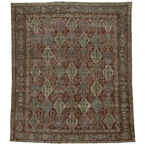 industrial mats rugs distressed antique bakhtiari rug with modern industrial style for sale at 1stdibs