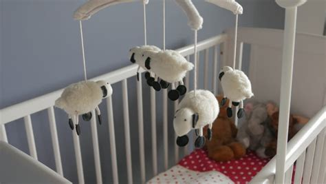 Lamb Nursery Mobile Spinning Above Baby Crib Close Up Baby Toys Above Crib