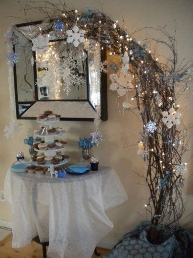 free standing half arch twigs and winter decorations
