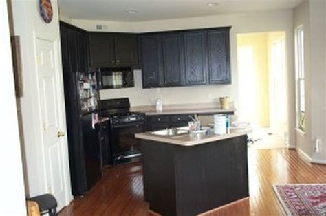black or white kitchen cabinets large brown wooden kitchen cabinet with stove also white