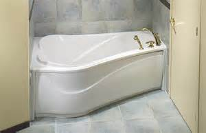 corner bathtubs oval white corner bathtub placed on the white floor