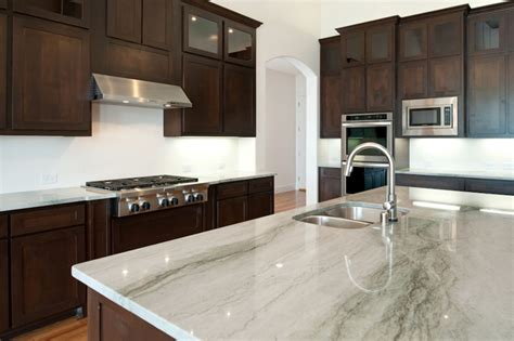 sleek white springs granite countertop with brown cabinet