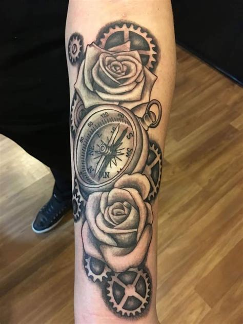 rose and compass tattoo black ink compass with roses and gears on left forearm