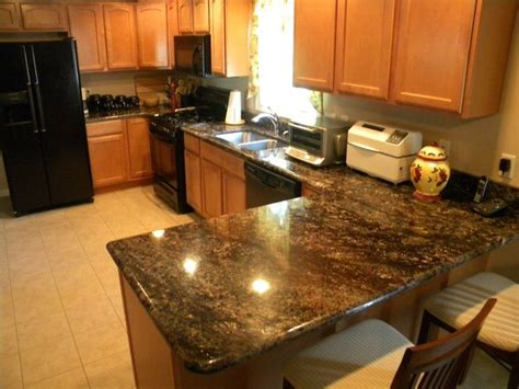 granite countertops with light cabinets pin by hope zbylicki on home