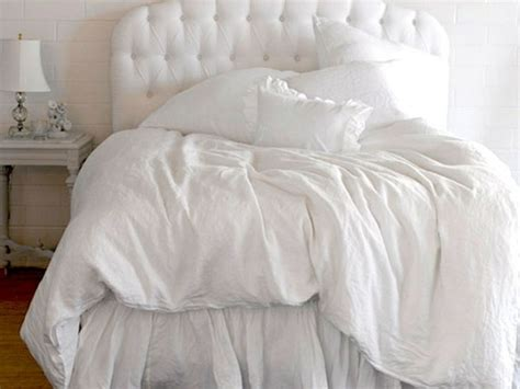 white tufted comforter ethereal spring whites love the tufted headboard and the