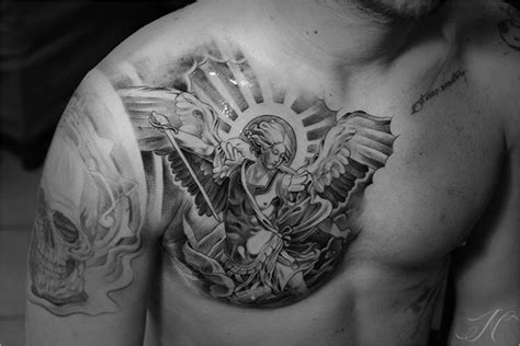 st michael chest tattoo arab pattern around shoulder arm chest and then