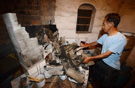 earthquake victim inspects damage   shattered home jiang   china daily