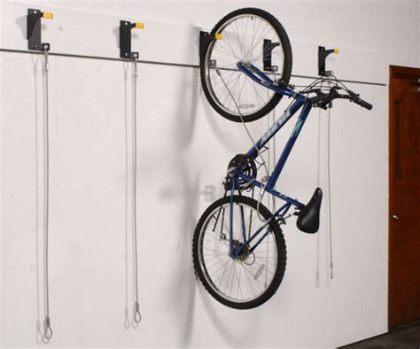 Bicycle Storage Rack by Wall Mounted Hanging Bike Racks Push Button Overhead
